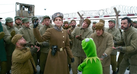 Prison supervisor Nadya (Tina Fey) hires Kermit to run a musical in Muppets Most Wanted (2014)